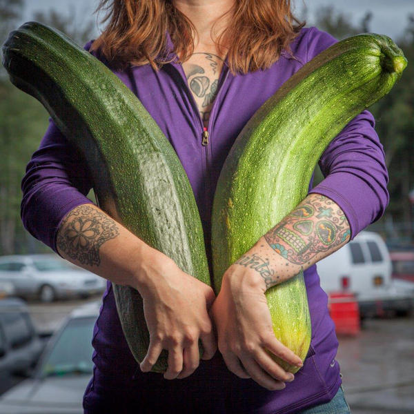 "Alaska grower Brittney Kauffman holds two zucchinis she entered in a giant vegetable competition in 2013. ""Alaska is just a hotbed for gardening, believe it or not,"" says Alaska State Fair crops superintendent Kathy Liska. ""Everybody thinks that we're always under ice — no!"""