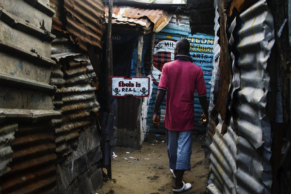 In Liberia, lots of people say Ebola isn't real. This sign in a West Point alley challenges that view.