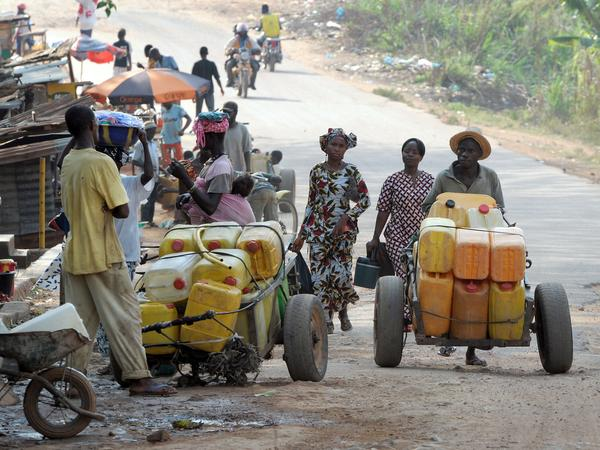Street vendors sell water on a street of Gueckedou — the city in Guinea where the Ebola outbreak began. Bordering Sierra Leone and Liberia, Gueckedou is a bustling city of more than 200,000 people.