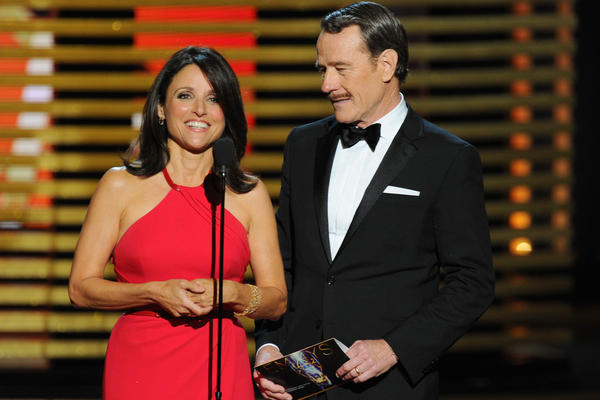 Julia Louis-Dreyfus and Bryan Cranston present the award for outstanding lead actor in a comedy series. Louis-Dreyfus later won the trophy for lead actress in a comedy series for <em>Veep</em>, and Cranston for best actor in a drama for <em>Breaking Bad</em>.