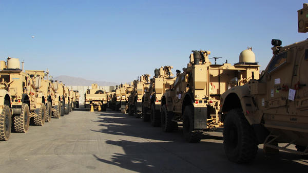Armored vehicles known as M-ATVs are lined up on the tarmac at Bagram Air Field. They will be flown out to the Persian Gulf on cargo planes and then shipped back to the U.S.