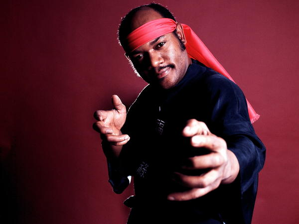 "Carl Douglas strikes a pose as he promotes his 1974 song, ""Kung Fu Fighting."""
