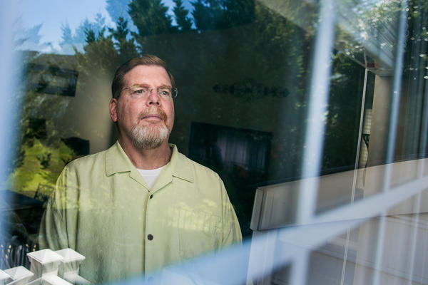Tom Murphy, 56, in his home in Gainesville, Va., was diagnosed with ALS four years ago. An experimental drug seems to have slowed the progression of his disease, he says, though most ALS patients aren't as lucky.