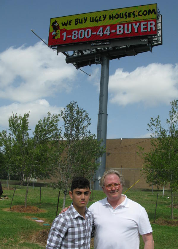 Don Glendenning, president of Scenic Dallas, stands with volunteer Marc Shidid below one of Dallas' new digital billboards.