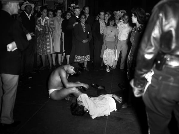 Young men were stripped of their clothes and badly beaten as policemen scoured the streets in Los Angeles for zoot-suited young men they blamed for petty crime.