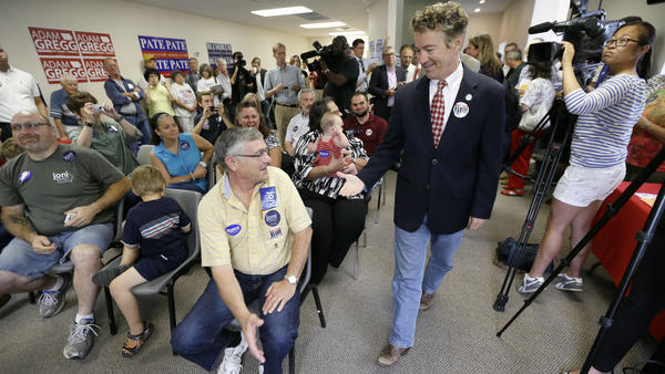 Sen. Rand Paul meets with local Republicans in Hiawatha, Iowa. He's made three trips to the state this year.