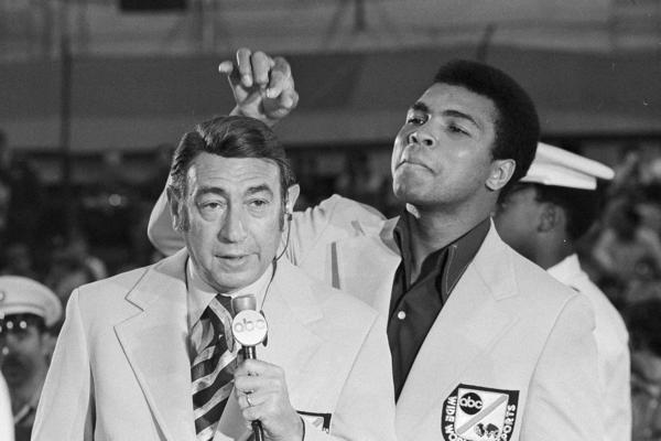 Ali toys with the finely combed hair of television sports commentator Howard Cosell before the start of the Olympic boxing trials, Aug. 7, 1972, in West Point, N.Y.