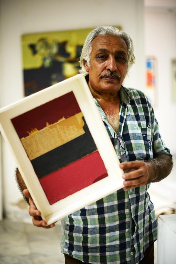 "Gallery owner Qassim Sabti. ""We just make art for art,"" he says."