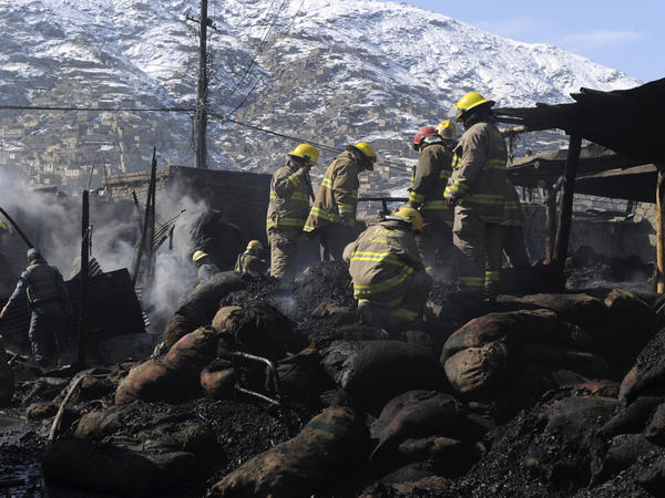 Kabul firefighters douse a coal market fire in 2011.