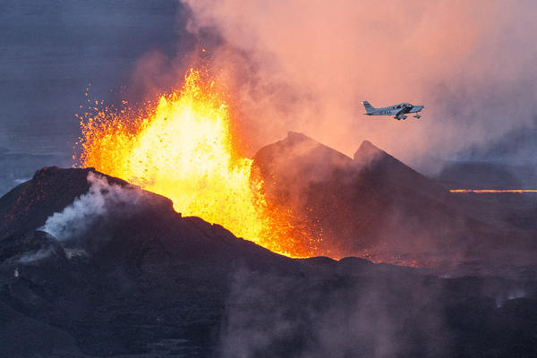 A plane flies over the Bardarbunga volcano as it spews lava and smoke in southeast Iceland on Sept. 14. The Bardarbunga volcano system has been rocked by hundreds of tremors a day since mid-August, prompting fears the volcano could explode.