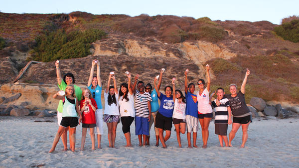 Members of the American Widow Project cheer at the end of an annual event in San Diego. The organization's mission is to help heal and empower participants.
