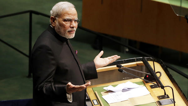 "Narendra Modi, Prime Minister of India, speaks at the UN General Assembly in New York City Saturday. Addressing the question of peace talks with Pakistan, Modi said they must happen ""without the shadow of terrorism."""