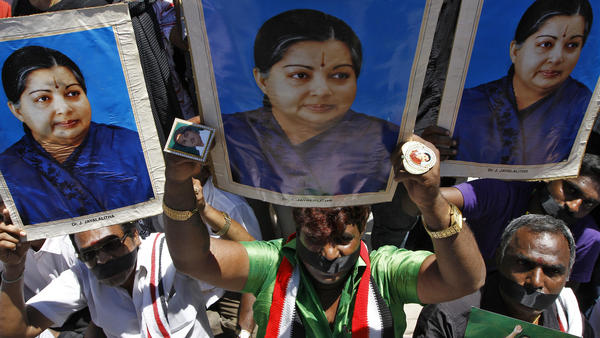 Supporters of J. Jayalalithaa, chief minister of India's Tamil Nadu state and head of the AIADMK party, hold a protest against a prison sentence for the popular politician in the southern Indian city of Chennai Sunday.