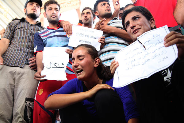 Displaced demonstrators from the minority Yazidi sect demonstrate outside the United Nations offices in Irbil, Iraq, on Aug. 4 in support of those held captive by the self-proclaimed Islamic State.
