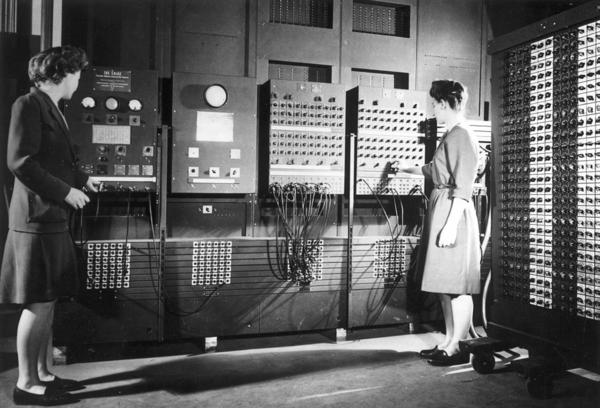 Jean Jennings (left) and Frances Bilas set up the ENIAC in 1946. Bilas is arranging the program settings on the Master Programmer.