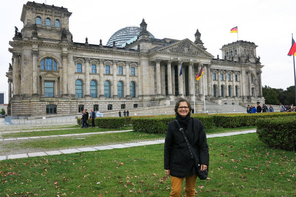 Annalie Schoen stands in front of the German parliament building in Berlin. She is a West German transplant who helped create a seamless capital after lawmakers moved the government from Bonn back to Berlin in 1991.