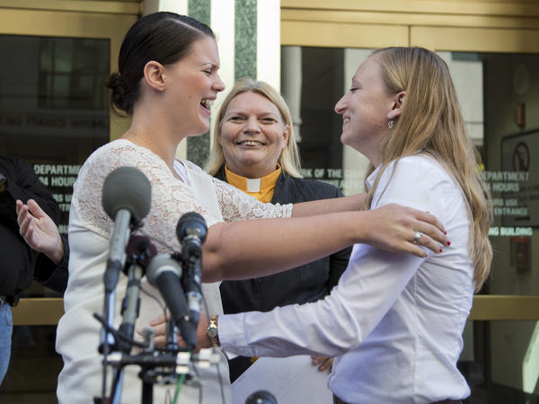 Jennifer Melsop and Erika Turner, from Centreville, Va., embrace after they were officially pronounced married. Virginia began issuing marriage licenses to same-sex couples just hours after the Supreme Court's action.