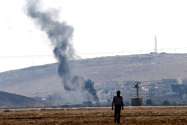 Smoke rises from buildings in Syria's Kobani city on the Turkish-Syrian border, near Sanliurfa, on Monday.