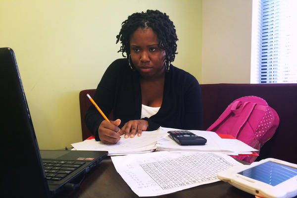 Ashjame Pendarvis, a first-year community college student, works on her math homework at the University of District of Columbia.