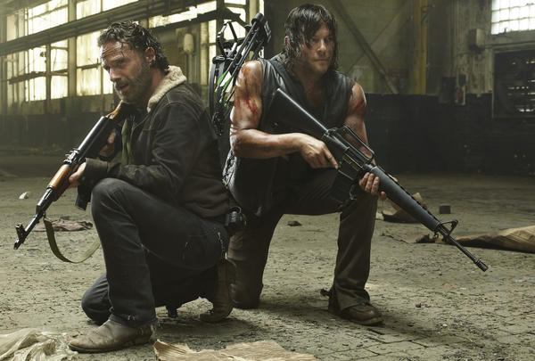 Andrew Lincoln, left, and Norman Reedus star in AMC's <em>The Walking Dead.</em>