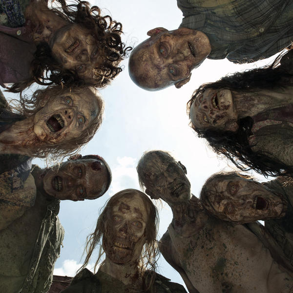 """A crowd of zombies, known as """"walkers,"""" on AMC's <em>The Walking Dead.</em>"""