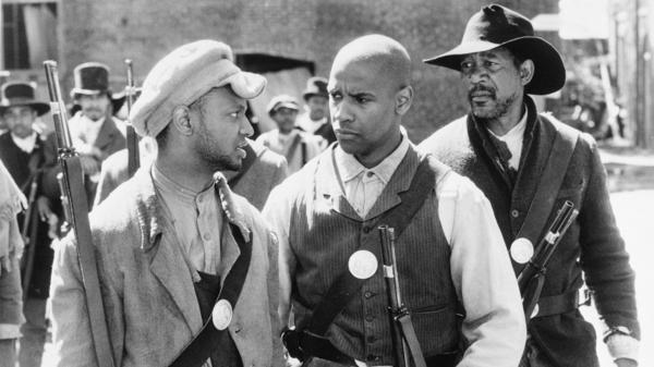 Actor Denzel Washington (center) is flanked by Jihmi Kennedy (left) and Morgan Freeman in the 1989 film <em>Glory</em>, a turning point in Hollywood's representations of the Civil War.
