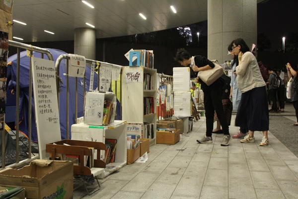 Protesters built a library in the parking lot of the Hong Kong leglislative council building. Volumes include <em>Pride and Prejudice</em> and <em>The Economics of John Maynard Keynes.</em>