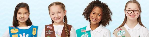 Girl Scouts model contemporary uniforms.