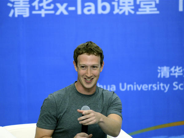 In a photo released by Tsinghua University in Beijing, Facebook co-founder Mark Zuckerberg speaks with students there on Wednesday.