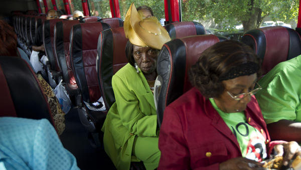 "Martha Frazier rides a bus to vote in Miami in 2012. This year, Georgia churches are running similar ""Souls to the Polls"" programs, busing worshipers to early voting locations after Sunday service."
