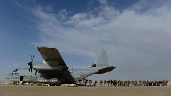 U.S. Marines board a C-130 transport plane as they withdraw from Camp Leatherneck, their huge base in southern Afghanistan. This marked the biggest handover yet to the Afghan army, which is facing a tough fight with the Taliban in Helmand province and other parts of southern Afghanistan.