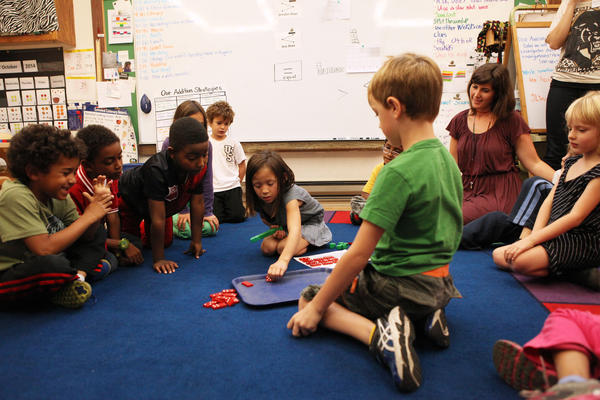 First-graders at Black Pine Circle School in Berkeley, Calif., learn basic addition using dominoes.