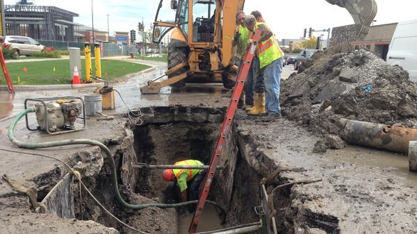 A water maintenance crew works on leaky infrastructure in Skokie, a Chicago suburb. The area loses almost 22 billion gallons of water a year because of ailing infrastructure.