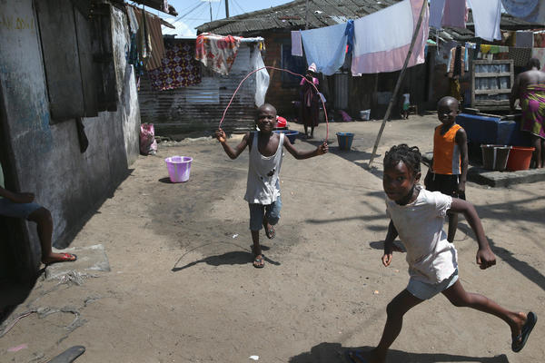 Children play in the West Point neighborhood of Monrovia last week. West Point has been hit hard by Ebola. So local leaders formed their own Ebola task force, which goes door to door looking for cases.