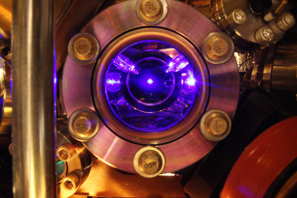 Strontium atoms floating in the center of this photo are the heart of the world's most precise clock. The clock is so exact that it can detect tiny shifts in the flow of time itself.