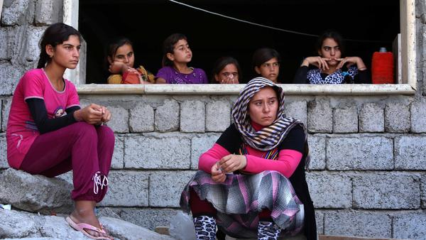 Iraqi Yazidi women who fled the violence in the northern Iraq take shelter in the city of Dohuk on Aug. 5. The Yazidis, are a small community that follows an ancient faith and have been repeatedly targeted by jihadists. Yazidi leaders say several thousands members of the community have gone missing in recent months.