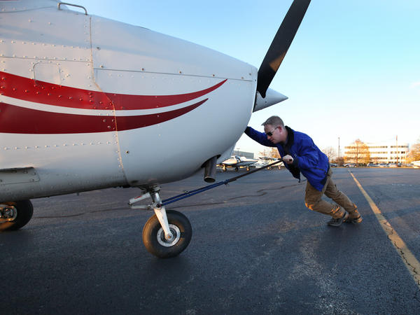 After an early evening flight, Weinstein pushes the Cessna back into its parking spot.