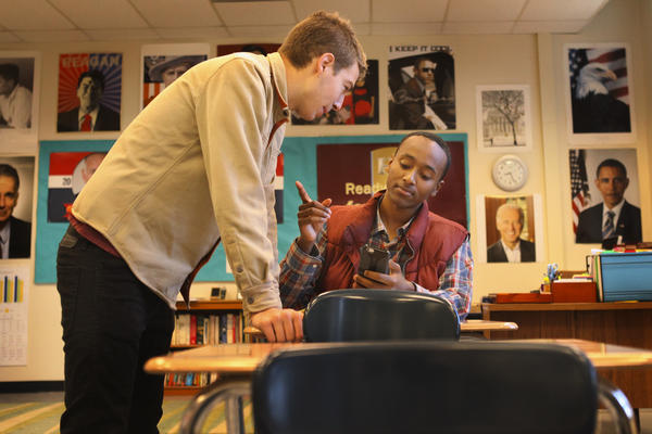 Student Mawi Fasil talks with a friend during a class break at Oakland Technical High School