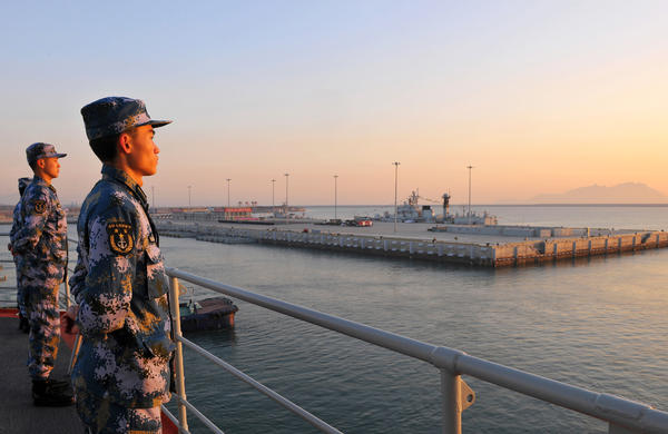 Chinese naval soldiers stand guard on China's first aircraft carrier, Liaoning, as it travels toward a military base in Hainan province, in this undated picture made available on Nov. 30, 2013. Tensions in the South China Sea have grown over territorial disputes between China, the Philippines, Japan and others.