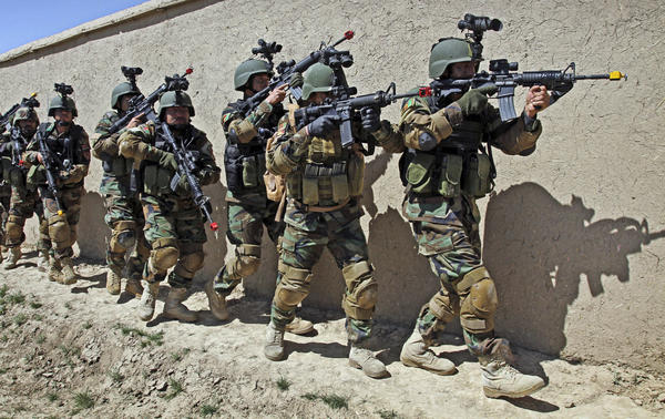 "Afghan special forces train for a hostage rescue operation in this 2012 photo. Campbell, the top U.S. commander, says the Afghan army has ""the capability to protect itself and is the strongest institution in the country."""