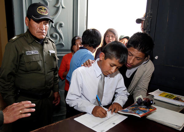 Carlos Cachari Ticona, 12, works with child laborers. He is among the adolescent workers who support the new law that allows kids as young as 10 to work.