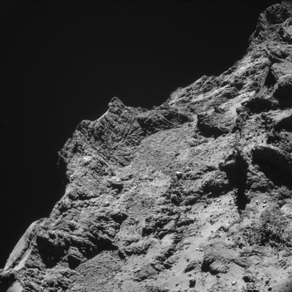 Newly released images taken from just 6 miles above the comet show high plateaus sticking up from its boulder-strewn surface.