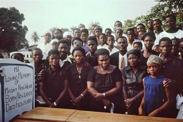 Mourners at graveside internment. Maryland County, Liberia, 1983.