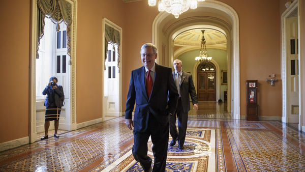 Senate Republican leader Mitch McConnell of Kentucky walks to his office to meet with new GOP senators-elect at the Capitol on Wednesday.
