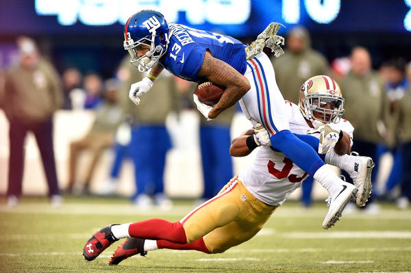 Eric Reid of the San Francisco 49ers tackles Odell Beckham of the New York Giants in the fourth quarter of Sunday's game at MetLife Stadium in East Rutherford, N.J.