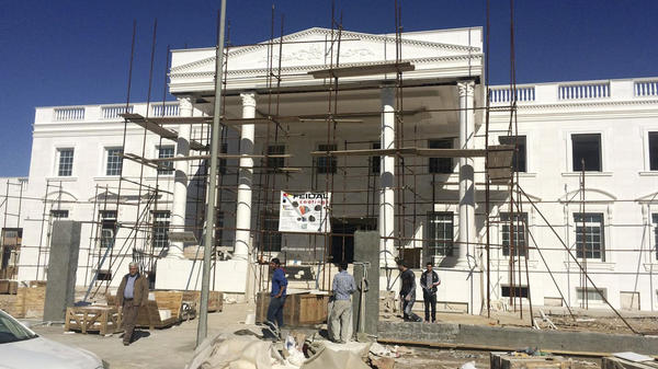 Construction workers in Irbil, in the Kurdish north of Iraq, work on Kurdish business tycoon Shihab Shihab's version of the White House.