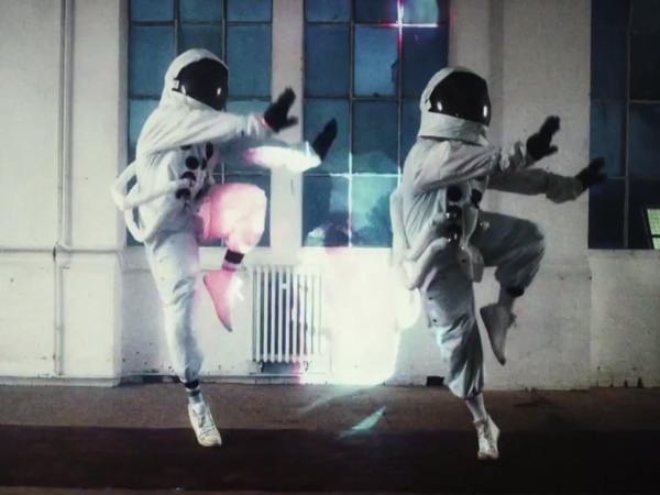 "Two astronauts bust a move in a scene from Public Service Broadcasting's new video for the song ""Gagarin."""