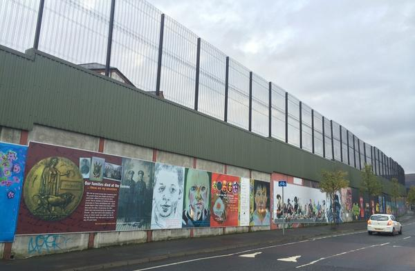This is one of the peace walls in Belfast that separates Catholic and Protestant neighborhoods. The first barriers were built in 1969 and meant to last only six months, but they have multiplied over the years and stand to this day.