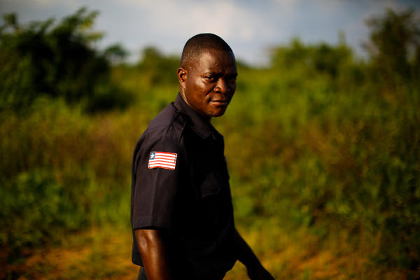 Sylvester Luogon of the Liberian National Police has been assigned to the border crossing for two months as part of a regular police rotation.