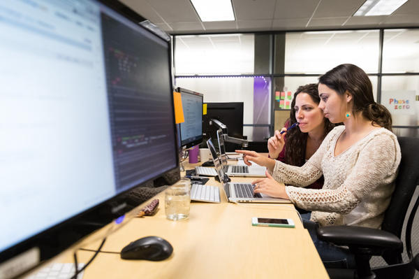 """At Dev Bootcamp in San Francisco, students spend most of the day in the """"lab,"""" pairing with one another on coding challenges."""